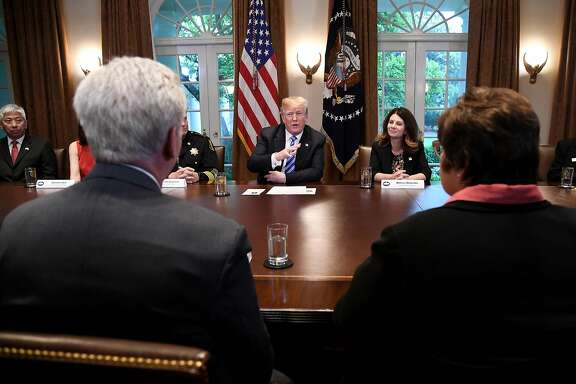 U.S. President Donald Trump, center, speaks during a meeting with California leaders and public officials in the Cabinet Room of the White House in Washington, D.C., U.S., on Wednesday, May 16, 2018. Trump�continued to defend the lifeline he offered to Chinese telecom-equipment maker ZTE Corp., insisting trade talks with Beijing are just getting started. Photographer: Olivier Douliery/Pool via Bloomberg