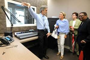 Tom Kuser, Program Director for WSHU radio, leads a tour of the station's new building and studios on the Sacred Heart University campus in Fairfield, Conn. May 16, 2018.
