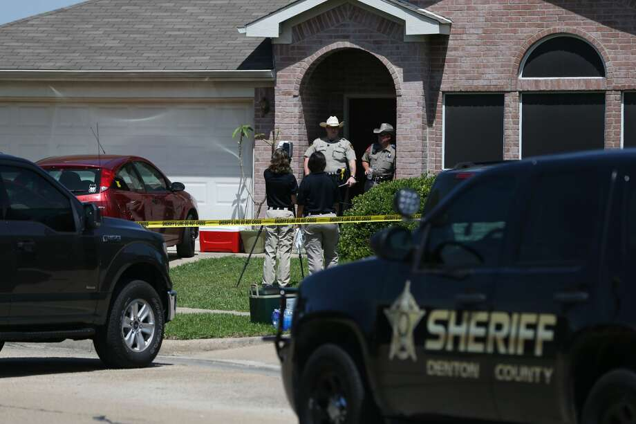 Denton County Sheriff's officers investigate a crime scene at a home where five people were killed and one was hospitalized after a shooting at a home in the Remington Park neighborhood of Ponder, Texas on Wednesday, May 16, 2018. (Rose Baca/The Dallas Morning News) Photo: Rose Baca/Staff Photographer