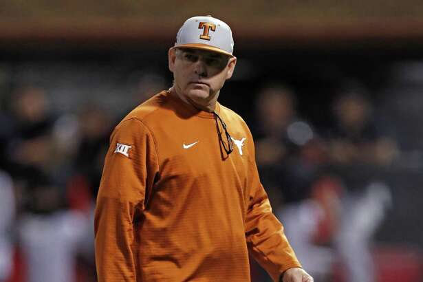 Texas coach David Pierce walks off the field during the team's game against Texas Tech on May 4 in Lubbock