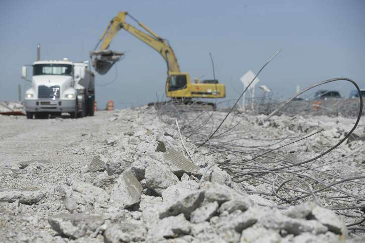 Construction work continues along the eastbound lanes of U.S. 290 near the Huffmeister Road overpass on May 16 in Houston. Crews are tearing out the pavement of the old main lanes near where the eastbound portion of the bridge was recently demolished.