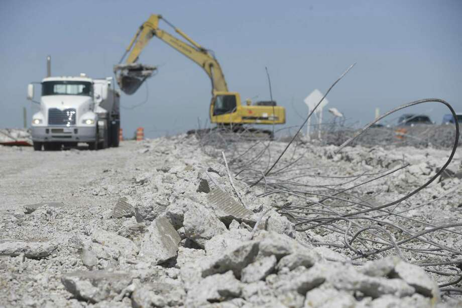Construction work continues along the eastbound lanes of U.S. 290 near the Huffmeister Road overpass on May 16 in Houston. Crews are tearing out the pavement of the old main lanes near where the eastbound portion of the bridge was recently demolished. Photo: Melissa Phillip,  Staff / Houston Chronicle / © 2018 Houston Chronicle