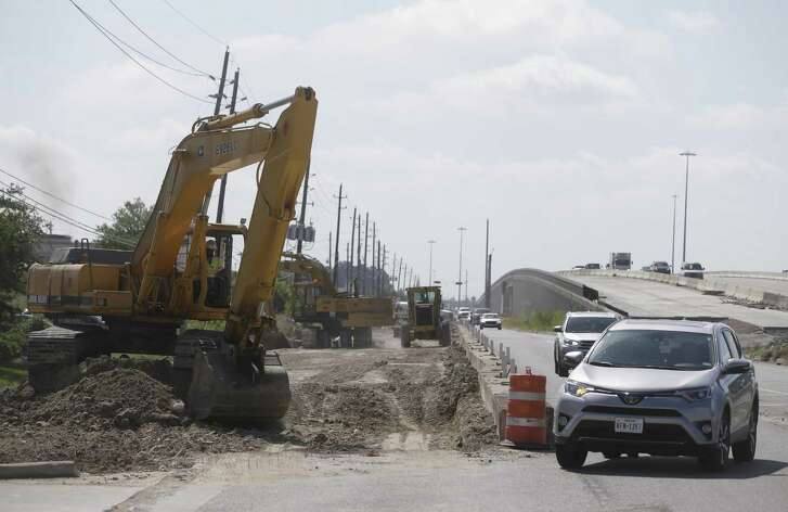 Construction work is shown along the westbound frontage road of U.S. 290 near Mueschke Road on May 16 in Cypress.