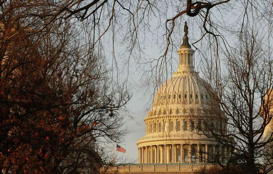 The U.S. Capitol has been the scene of many contentious debates over the years, but as a symbol of the nation, the building itself seems to rise above the hostility. Photo: JIM BOURG /REUTERS / X90054