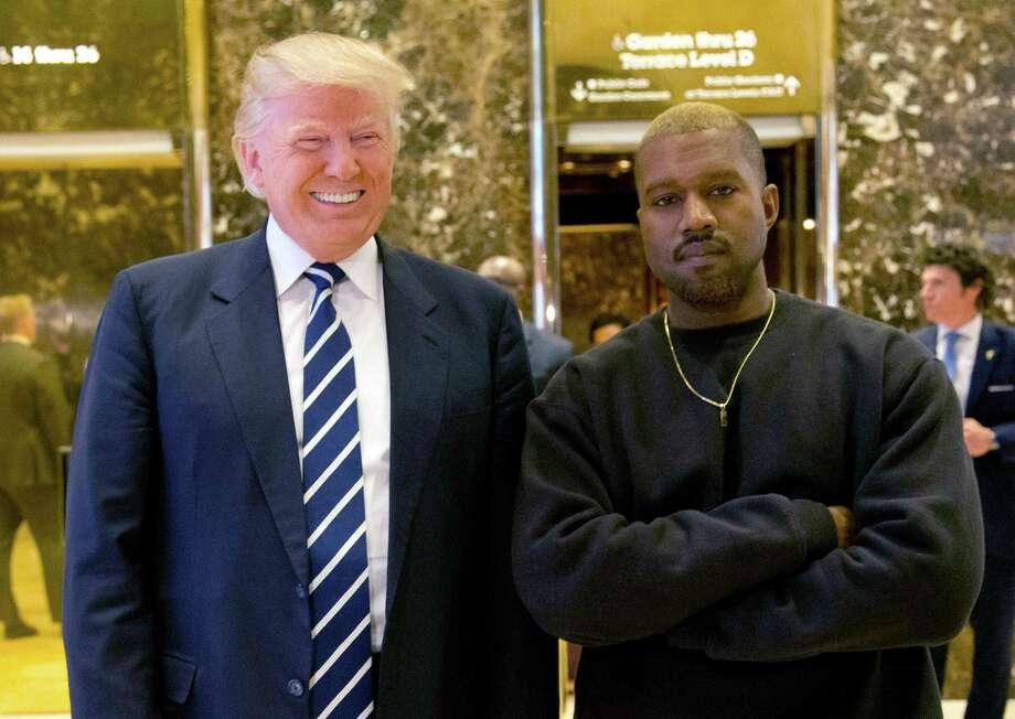 Then-President-elect Donald Trump and Kanye West pose for a picture in the lobby of Trump Tower in New York in 2016. Photo: Seth Wenig /AP / Copyright 2016 The Associated Press. All rights reserved.