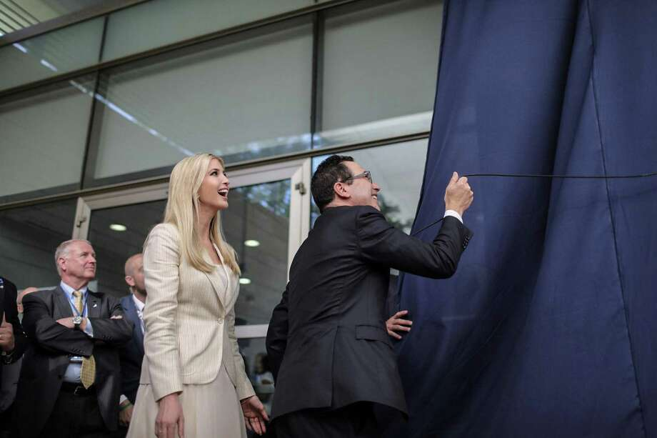 White House senior advisor Ivanka Trump, left, smiles as U.S. Treasury Secretary Steven Mnuchin unveiled a plaque during the opening ceremony of the new U.S. embassy in Jerusalem on Monday. Meanwhile, Israeli forces killed protesting Palestinians in Gaza. Photo: Ilia Yefimovich /DPA /TNS / Zuma Press