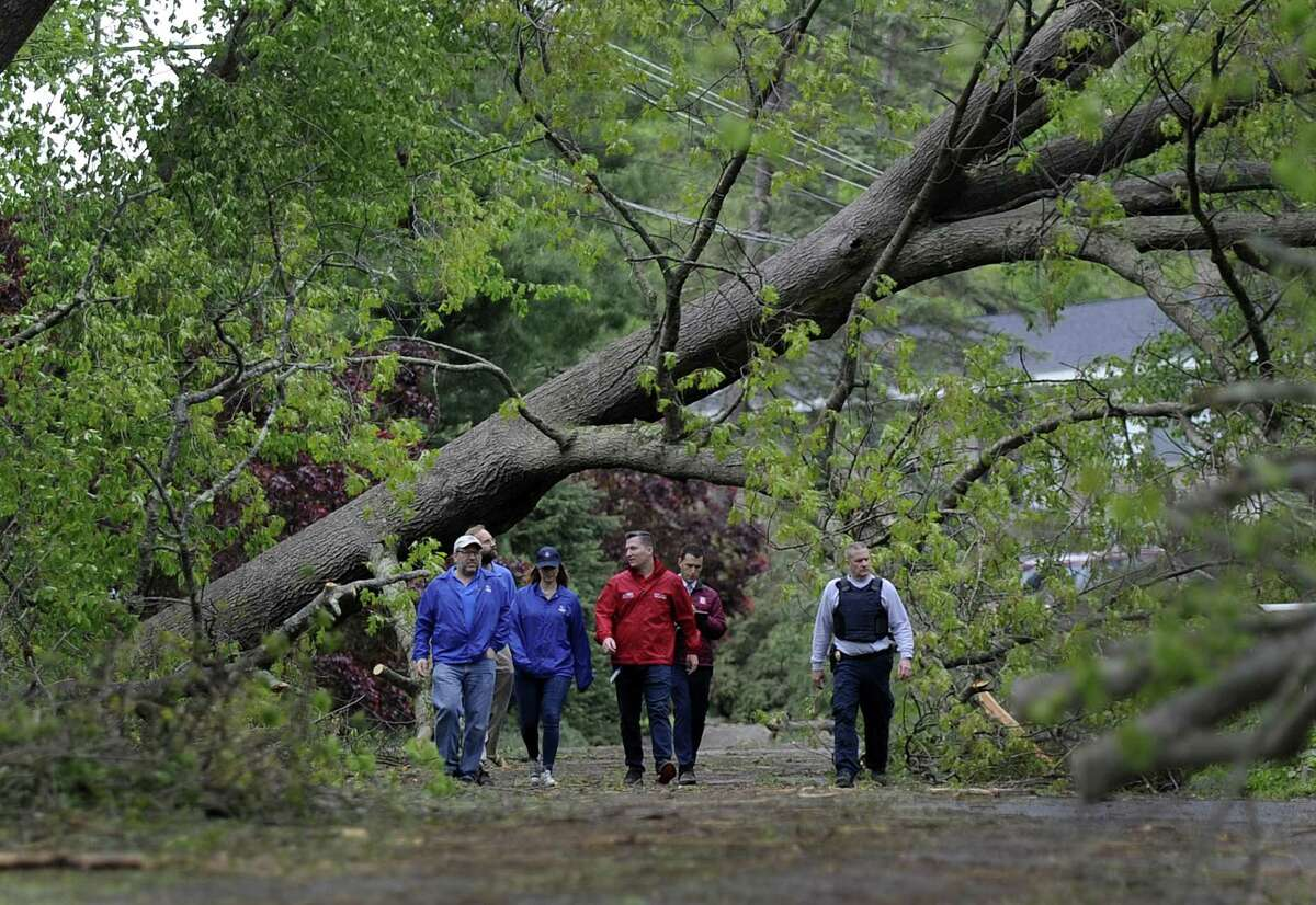A National Weather Service team, including meteorologist Bill Goodman, far left, tours Brookfield along with State Police on Wednesday to assess damage from Tuesday's storm. The team concluded that the damage was most likely caused by a