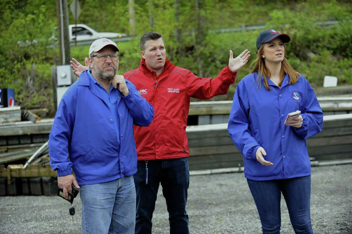 Bill Goodman, left, and Carlie Buccola, right, meterologists with the National Weather Service, tour Candlewood Shores in Brookfield to assess storm damage and determine if Tuesday's weather was the result of a tornado. They are joined by State Police and media, Wednesday, May 16, 2018.