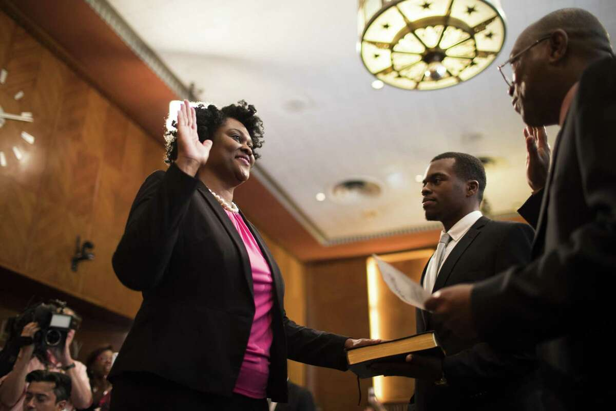 Martha Castex-Tatum is sworn as City Houston Council Member District K in the presence of her son and Mayor Sylvester Turner, Wednesday, May 16, 2018, in Houston. ( Marie D. De Jesus / Houston Chronicle )
