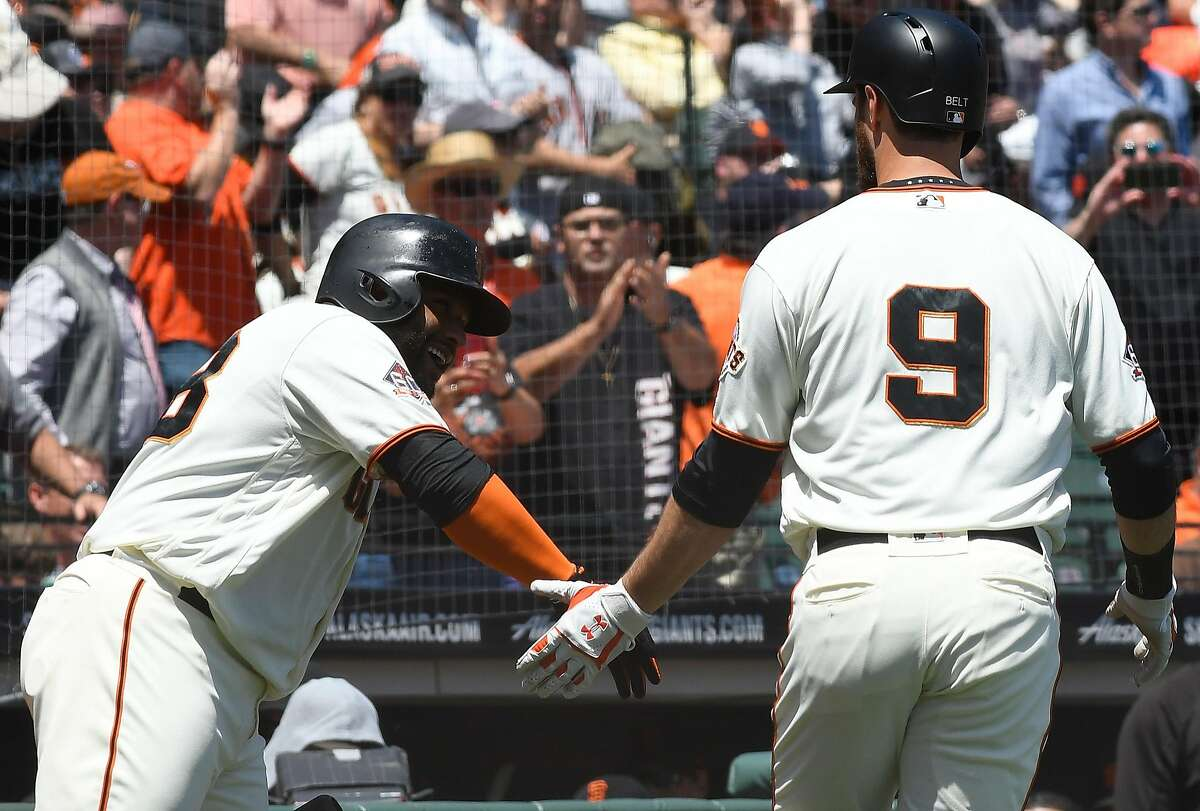 SAN FRANCISCO, CA - MAY 16: Brandon Belt #9 of the San Francisco Giants is congratulated by Pablo Sandoval #48 after Belt hit a solo home run against the Cincinnati Reds in the bottom of the third inning at AT&T Park on May 16, 2018 in San Francisco, California. (Photo by Thearon W. Henderson/Getty Images)