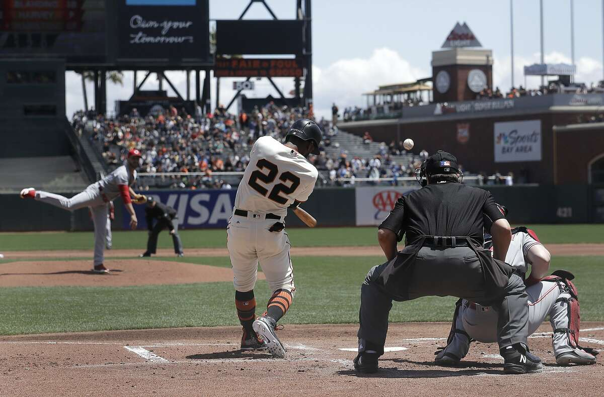 San Francisco Giants' Andrew McCutchen (22) hits an RBI-double off of Cincinnati Reds pitcher Matt Harvey, left, during the first inning of a baseball game in San Francisco, Wednesday, May 16, 2018. (AP Photo/Jeff Chiu)
