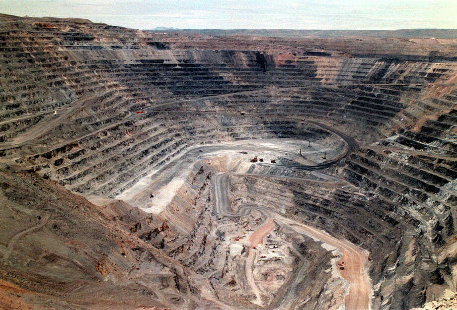 FILE - This undated file photo shows Barrick Goldstrike Mines' Betze-Post open pit near Carlin, Nev. Environmental groups challenged the Trump administration in federal court Wednesday, May 16, 2018, over its rejection of an Obama-era proposal that would have required mining companies to prove they have enough money to clean up their pollution. (Adella Harding/The Daily Free Press via AP, File) Photo: Adella Harding / The Daily Free Press