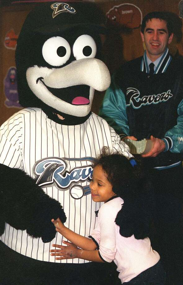 "In this file photo, SPECTRUM/Northville Elementary School student Brianna Jackson hugs Rally, the New Haven Ravens' mascot, during the school's ""Rally Around Reading"" literature week. Photo: Hearst Connecticut Media File Photo / The News-Times File Photo"