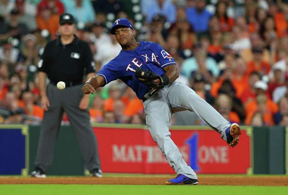 Adrian Beltre of the Texas Rangers throws to first base in the fourth inning attempting against the Houston Astros at Minute Maid Park on May 11 in Houston. Photo: Bob Levey /Getty Images / 2018 Getty Images