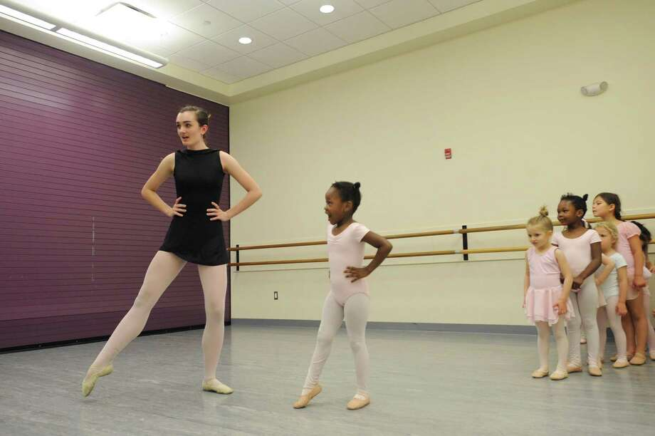 16-year-old Lauralton Hall junior Maura McHugh, of Stamford, demonstrates the proper form while teaching a ballet class to four-year-old girls inside the Ballet School of Stamford at Chelsea Piers in Stamford, Conn. on Wednesday, May 16, 2018. McHugh will play the witch in the 80-person cast of Hansel and Gretel. Photo: Michael Cummo / Hearst Connecticut Media / Stamford Advocate