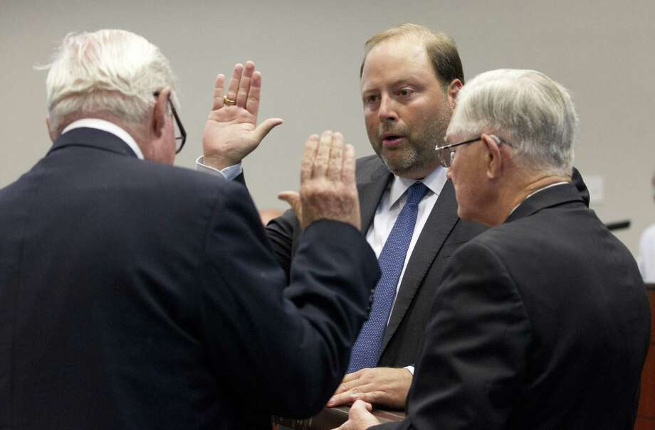 Mayor Pro Tem Duke Coon is sworn into office during by former Montgomery County Judge Jimmie Edwards III, right, beside Mayor Toby Powell during a ceremony for Coon and newly elected Conroe City Council member Jody Czajkoski at Conroe Tower on Wednesday, May 16, 2018, in Conroe. Photo: Jason Fochtman, Staff Photographer / Houston Chronicle / © 2018 Houston Chronicle