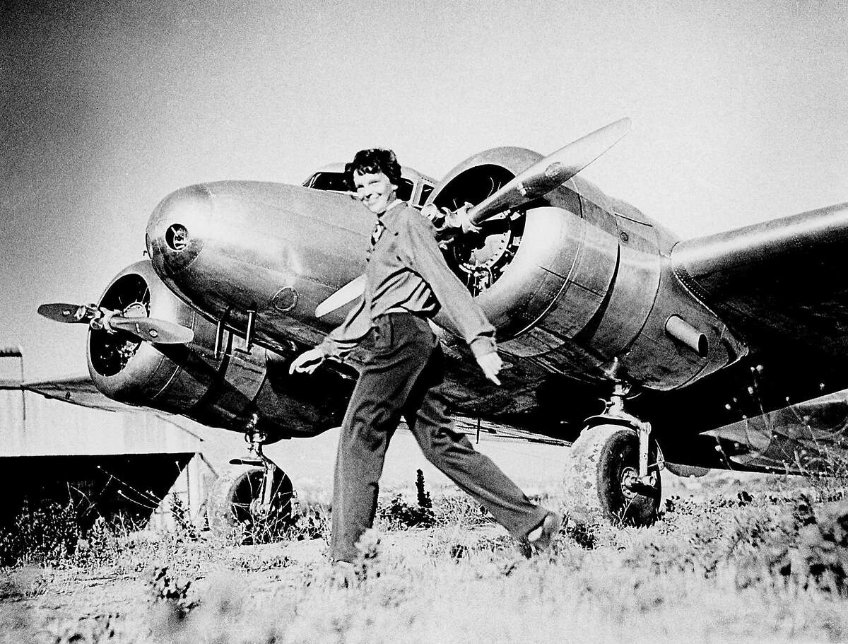 Amelia Earhart, who served as a consultant in the Department of the Study of Careers for Women at Purdue from 1935 to 1937, strides past her Lockheed Electra. Sally Putnam Chapman has donated 492 Earhart items �? including rarely seen personal and private papers such as poems, a flight log and a prenuptial agreement �? to Purdue Libraries' Earhart collection. (File photo) A publication-quality photograph is available at ftp://ftp.purdue.edu/pub/uns/earhart.newdocs/earhart.electra.jpeg.