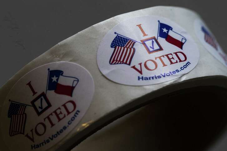 """I Voted"" stickers ready to be distributed sit on top of a table at a polling place, Saturday, May 5, 2018, on special election day in Houston."