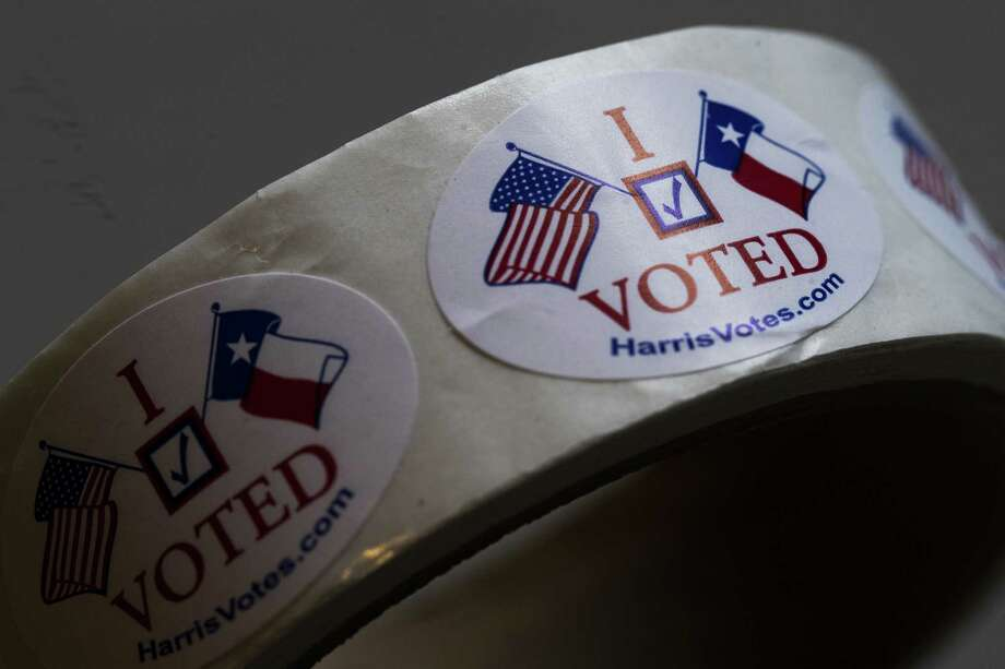 """I Voted"" stickers ready to be distributed sit on top of a table at a polling place, Saturday, May 5, 2018, on special election day in Houston. Photo: Marie D. De Jesus, Houston Chronicle / Houston Chronicle / © 2018 Houston Chronicle"
