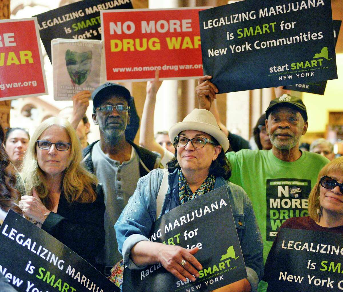 Advocates rally outside the Senate Chambers to demand marijuana legalization in New York at the Capitol Tuesday May 8, 2018 in Albany, NY. (John Carl D'Annibale/Times Union)