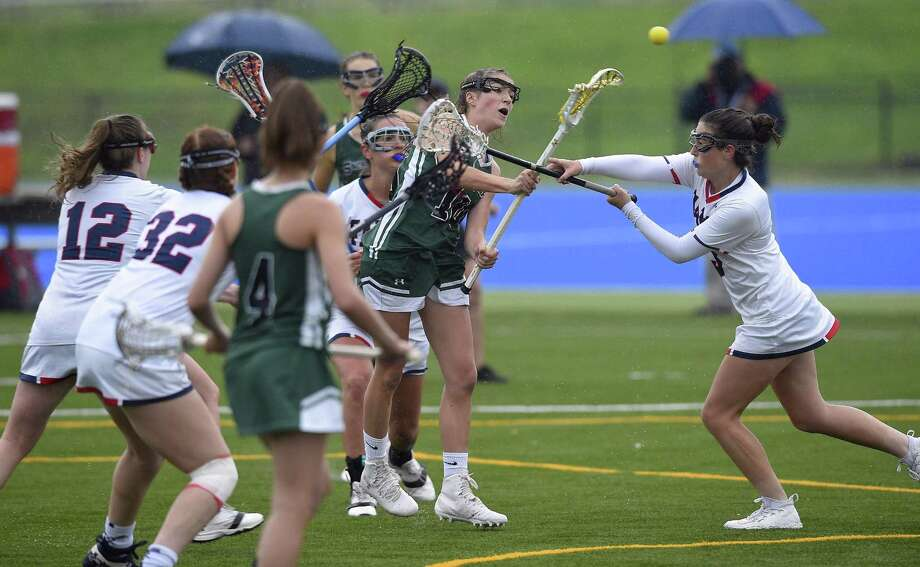 Sacred Heart's Lillian DeConcini (10) sweeps in, scoring on Green Farms Academy Sarah Peltier (3) in the first half of a  FAA Tournament semifinal lacrosse game at Sacred Heart in Greenwich, Conn. on May 16, 2017. Sacred Heart won 17-1. Photo: Matthew Brown / Hearst Connecticut Media / Stamford Advocate