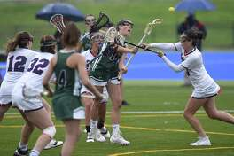 Sacred Heart's Lillian DeConcini (10) sweeps in, scoring on Green Farms Academy Sarah Peltier (3) in the first half of a  FAA Tournament semifinal lacrosse game at Sacred Heart in Greenwich, Conn. on May 16, 2017. Sacred Heart won 17-1.