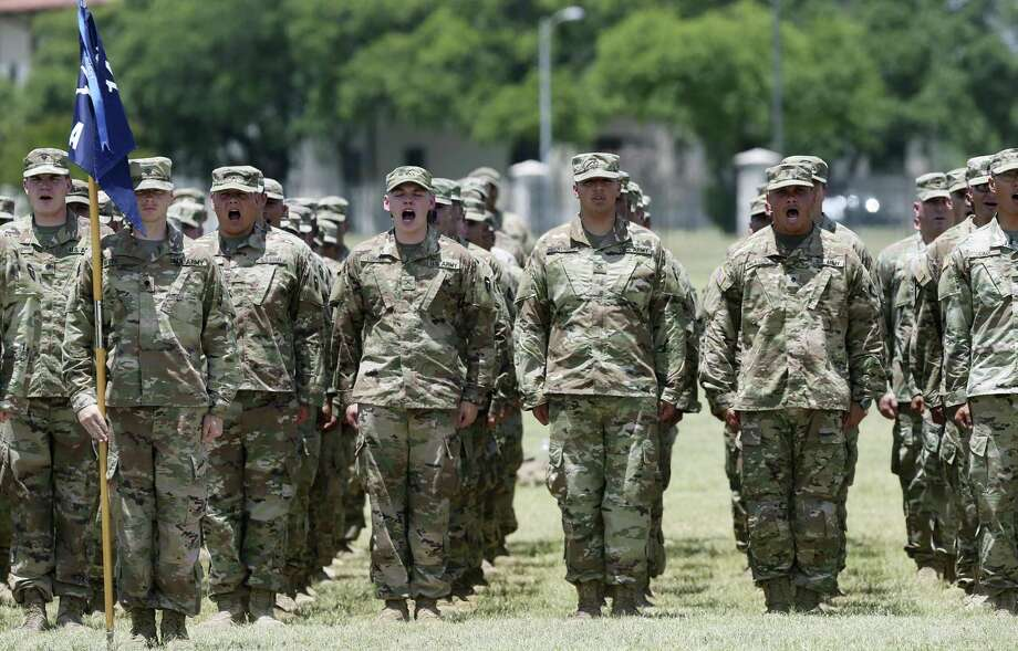 Soldiers with the Texas Army National Guard 1st Battalion, 141st Infantry Regiment of the 72nd Infantry Brigade Combat Team line up in formation during their deployment ceremony at Fort Sam Houston, Wednesday, May 16, 2018. The battalion, numbering close to 500, will deploy to the Horn of Africa. Photo: JERRY LARA / San Antonio Express-News / San Antonio Express-News
