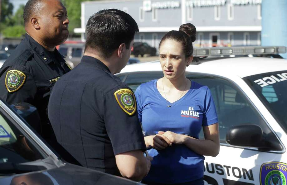 Houston Police officers arrest Natalia Ortiz at El Muelle Seafood, 6705 Airline Dr. Wednesday, May 16, 2018, in Houston. Prosecutors say she is the bartender who served Edin Palacios 11 beers the night in May 2016 when he got drunk and fled police and crashed into and killed Jocelynn Valero, 18, who was on her way home from prom. Photo: Melissa Phillip / Houston Chronicle