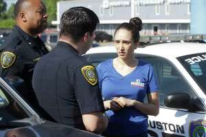 Houston Police officers arrest Natalia Ortiz at El Muelle Seafood, 6705 Airline Dr. Wednesday, May 16, 2018, in Houston. Prosecutors say she is the bartender who served Edin Palacios 11 beers the night in May 2016 when he got drunk and fled police and crashed into and killed Jocelynn Valero, 18, who was on her way home from prom.