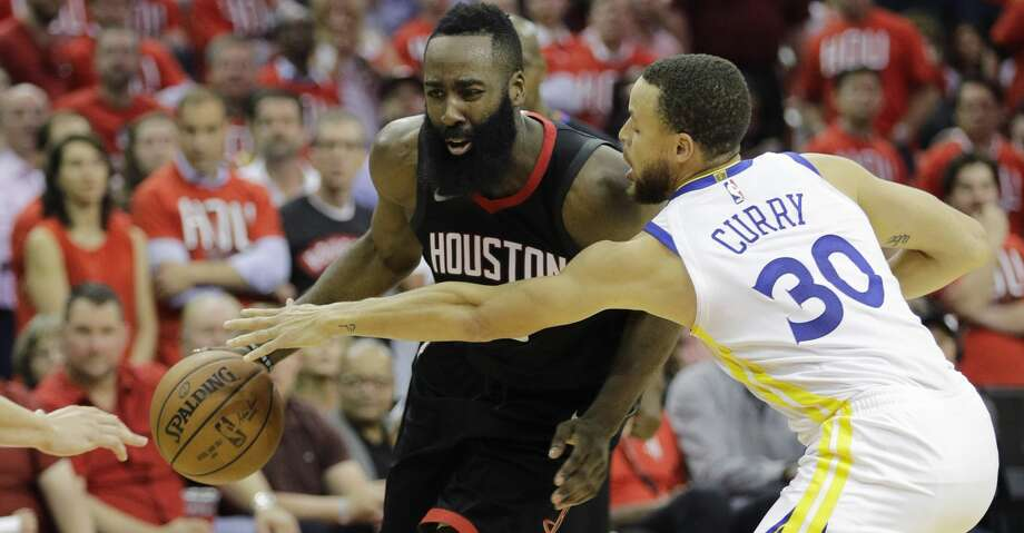 Houston Rockets guard James Harden (13) is pressured by Golden State Warriors guard Stephen Curry (30) during the second half of Game 1 of the NBA basketball Western Conference Finals, Monday, May 14, 2018, in Houston. (AP Photo/David J. Phillip) Photo: David J.Phillip/Associated Press