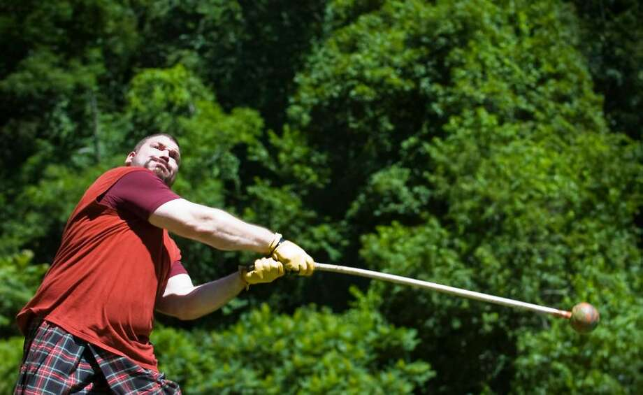 Rob Hamelin, of Wallingford, competes in the 16 lb hammer toss at the 87th Annual Round Hill Highland Games at Cranbury Park in Norwalk, Conn. on Saturday July 3, 2010. Photo: Kathleen O'Rourke / Stamford Advocate