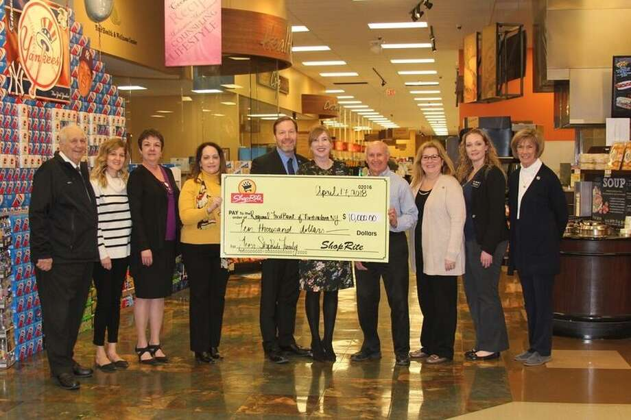From left: Village of Colonie Mayor Frank Leak, Jaci Balcombe, Rondi Edmonson, Joanne Dwyer, Tom Urtz, Sarada Bernstein, Mark Quandt, Mary Rozak, Shannon DeFreese and Linda Murray pose for a check presentation at ShopRite of Colonie. (Submitted photo)