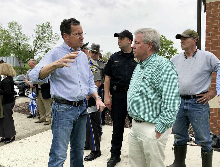 Gov. Dannel Malloy meets with Brookfield First Selectman Steve Dunn about the damaged caused after a line of powerful thunderstorms tore through the state Tuesday evening. The National Weather Service was also in town to access storm damage on Wednesday, May 16, 2018. Photo: Carol Kaliff / Hearst Connecticut Media / The News-Times