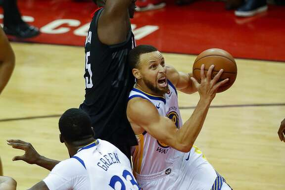 Golden State Warriors guard Stephen Curry (30) shoots around Houston Rockets center Clint Capela (15) during Game 2 of the Western Conference Finals at the Toyota Center, Wednesday, May 16, 2018, in Houston. ( Karen Warren  / Houston Chronicle )