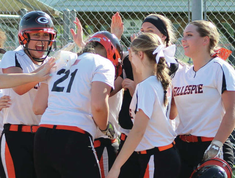 Gillespie freshman Sydney Bires (21) is greeted at the plate by teammates after hitting her walk-off home run in the fifth inning of the Miners' 10-0 win over EA-WR on Wednesday in Hillsboro. Photo:       Greg Shashack / The Telegraph