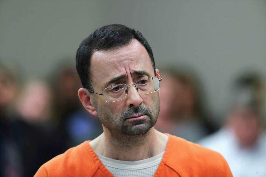 FILE - In this Nov. 22, 2017, file photo, Dr. Larry Nassar appears in court for a plea hearing in Lansing, Mich. Michigan State University has reached a $500 million settlement with hundreds of women and girls who say they were sexually assaulted by Nassar in the worst sex-abuse case in sports history. The deal was announced Wednesday, May 16, 2018, by Michigan State and lawyers for 332 victims. (AP Photo/Paul Sancya, File) Photo: Paul Sancya / Copyright 2018 The Associated Press. All rights reserved.