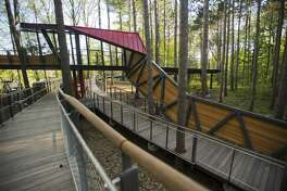 Scenes from a sneak peek tour of the new amenities at Whiting Forest, including a canopy walk, pedestrian bridges, a playground, a forest classroom and a cafŽe, on Wednesday, May 16, 2018. The forest is now scheduled to open in early October 2018. (Katy Kildee/kkildee@mdn.net)