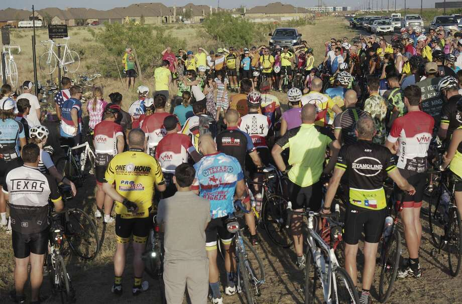 More than 100 bicyclists joined together 05/16/18 evening for the 13th annual Permian Basin Ride of Silence, to remember bicyclists killed on the roads riding their bike. Riders left the CEED building at 191 and 1788 and rode to the memorial site off Hwy 158 to honor Camron Stotts and Mike Mestas, who were recently killed while riding their bikes. Tim Fischer/Reporter-Telegram Photo: Tim Fischer/Midland Reporter-Telegram