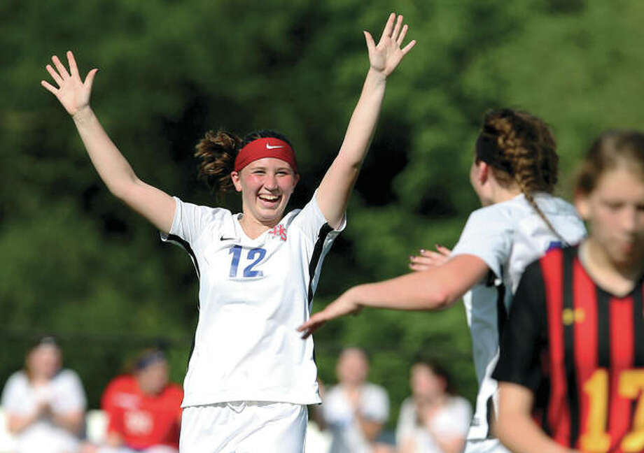 Carlinville's Taylor Wills raises her arms as she celebrates with teammate Lexi Egelhoff after Egelhoff scored the team's second goal against Warrensburg-Latham in the second half of Wednedday's Class 1A Sectional semifinal game at decautur Lutheran. Wills scored the Cavies' other goal and Carlinville won 2-0 to advance to Friday's sectional final against Champaign St. Thomas More. Photo:     Jim Bowling, Decatur Herald & Review | For The Telegraph