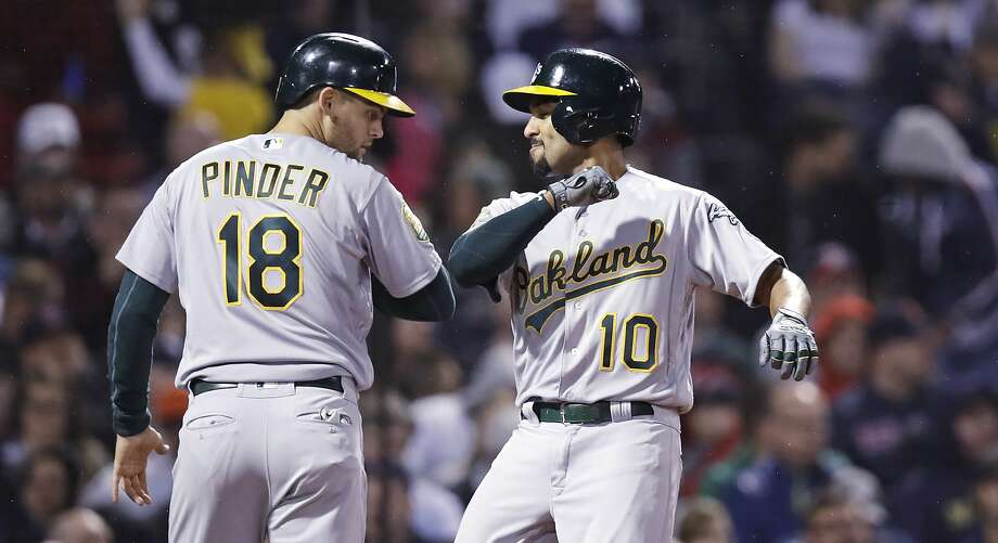 Oakland Athletics' Marcus Semien (10) is congratulated by Chad Pinder after his two-run home run off Boston Red Sox starting pitcher Chris Sale during the fifth inning of a baseball game at Fenway Park in Boston, Wednesday, May 16, 2018.  Photo: Charles Krupa / Associated Press