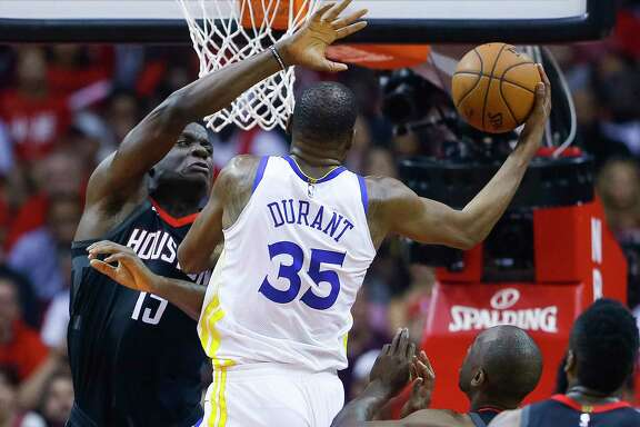 Houston Rockets center Clint Capela (15) defends Golden State Warriors forward Kevin Durant (35) during Game 2 of the Western Conference Finals at the Toyota Center, Wednesday, May 16, 2018, in Houston.