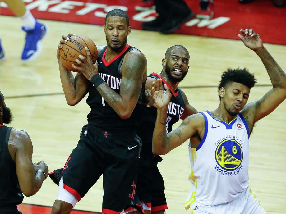 Rockets forward Trevor Ariza (1) grabs a rebound in a crowd with teammate Chris Paul (3) and Warriors guard Nick Young (6) during the first half of Game 2 of the Western Conference Finals on Wednesday at Toyota Center. Photo: Karen Warren, Houston Chronicle / © 2018 Houston Chronicle