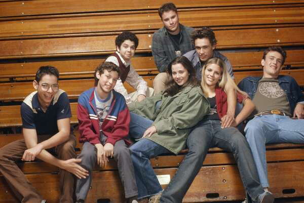 FREAKS AND GEEKS -- Season 1 -- Pictured: (front rpw l-r) Martin Starr as Bill Haverchuck, John Francis Daley as Sam Weir, Linda Cardellini as Lindsay Weir, Busy Philipps as Kim Kelly, Jason Segel as Nick Andopolis, (back row l-r) Samm Levine as Neal Schweiber, Seth Rogen as Ken Miller, James Franco as Daniel Desario, -- (Photo by: Chris Haston/NBC/NBCU Photo Bank via Getty Images)