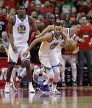 Stephen Curry (30) scrambles up the court after getting a rebound in the first half as the Golden State Warriors play the Houston Rockets in Game 2 of the Western Conference Finals at Toyota Center in Houston, Texas, on Wednesday, May 16, 2018.