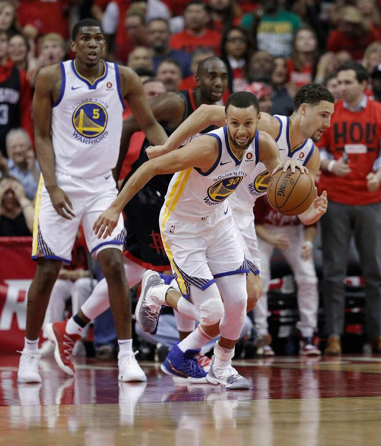 Stephen Curry (30) scrambles up the court after getting a rebound in the first half as the Golden State Warriors play the Houston Rockets in Game 2 of the Western Conference Finals at Toyota Center in Houston, Texas, on Wednesday, May 16, 2018. Photo: Carlos Avila Gonzalez / The Chronicle