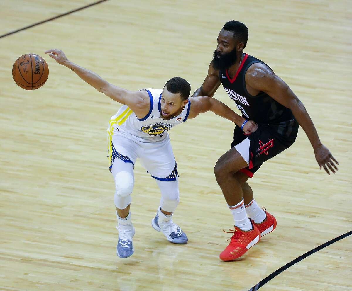 The ball slips out of Golden State Warriors guard Stephen Curry's (30) hand when Houston Rockets guard James Harden (13) is defensing during the first half of Game 2 of the Western Conference Finals at the Toyota Center, Wednesday, May 16, 2018, in Houston. ( Karen Warren / Houston Chronicle )