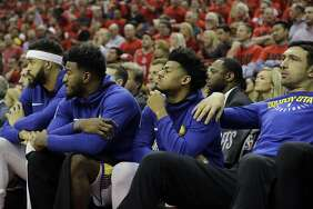 Golden State Warriors players sit on the bench during the second half in Game 2 of the NBA basketball Western Conference Finals against the Houston Rockets, Wednesday, May 16, 2018, in Houston.