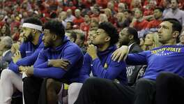 Golden State Warriors players sit on the bench during the second half in Game 2 of the NBA basketball Western Conference Finals against the Houston Rockets, Wednesday, May 16, 2018, in Houston. (AP Photo/David J. Phillip)
