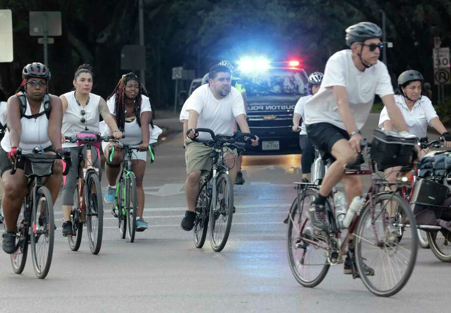 "Area cyclist ride down Sunset during a 10-mile route  on Wednesday, May 16, 2018 in Houston. Over 100 local riders were joining other cyclists worldwide in the ""Ride of Silence"" to bring attention to those who have died while riding their bicycles on local roads. Photo: Elizabeth Conley, Houston Chronicle / ©2018 Houston Chronicle"
