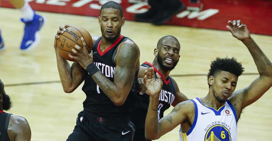 Houston Rockets forward Trevor Ariza (1) grabs a rebound against teammate Chris Paul (3) and Golden State Warriors guard Nick Young (6) during the first half of Game 2 of the Western Conference Finals at the Toyota Center, Wednesday, May 16, 2018, in Houston. ( Karen Warren  / Houston Chronicle ) Photo: Karen Warren/Houston Chronicle